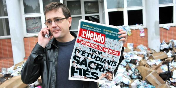 Charb lit l'Hebdo